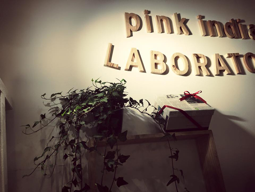 Pink india logo in woodblock letters in the store